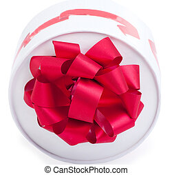 Gift box with red ribbon isolated on a white background