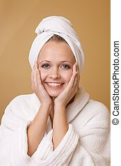 Happy Woman Getting Beauty Treatment Wearing Towel