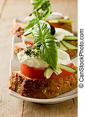 Caprese starter - photo of delicious sliced cereal bread...
