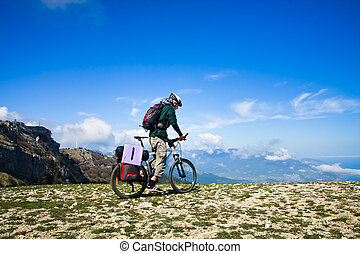 man riding a bike - Young man riding a bike over the...