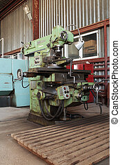Milling machine. - Old oily milling machine in the shop.