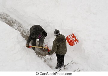 2 worker cleaning deep snow.