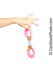 Caucasian girl`s hand holding handcuffs. Isolated on white.