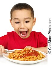 kid and spaghetti - six year old boy ready to eat a full...