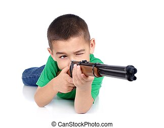 kid shooting a gun - six-year-old boy aiming a toy rifle,...