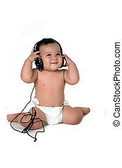 a young Asian girl listen to music with headphones isolated...