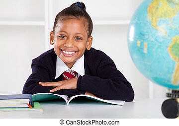 happy elementary school girl in classroom