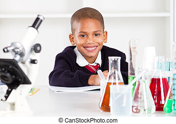 primary schoolboy in science lab - happy primary schoolboy...
