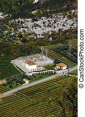 power plant, surrounded by vineyards. Aerial