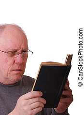 Older Balding Man in gray Shirt Reading a Black Book or...