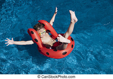 Attitude - Young boy with attitude showing floating in a...