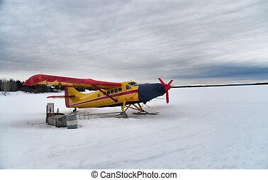 Hydro plane - Landed hydro plane on a frozen lake
