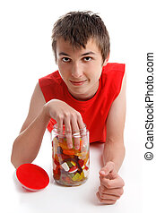 Boy with hand in lolly jar