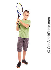 Child playing tennis - Child playing training with a field...