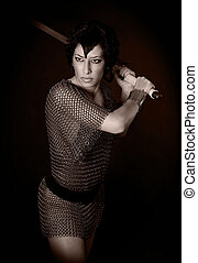 girl in chainmail - girl in chain armor brandishing a sword