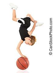 Young Girl Child Balancing Upsidedown on Basketball over...