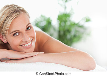 Close up of a blonde woman lying on a lounger in a wellness...