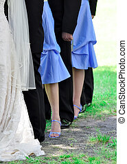 Wedding Party - Bride, bridesmaids and ushers line up on the...