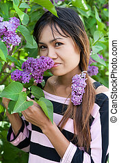 Beautiful Thai woman with lilac flower