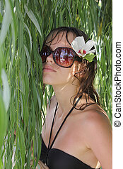 girl costs under tree leaves - girl in sun glasses costs...