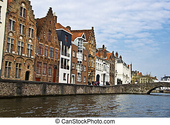 Bruges. Belgium. Medieval houses on the canal. Town Quay and...