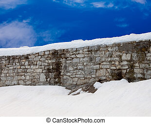 Snowy Wall with blue sky - Snowy stone wall with blue sky...