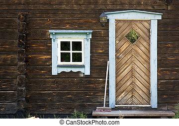 Facade of log cabin - Facade of rural brown log cabin with...
