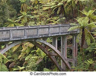 Lonely jungle bridge - A concrete bridge in the middle of...