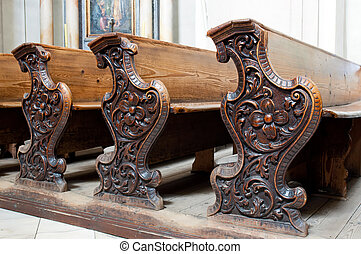 Church Pews - Detailed view of an old wooden church pews.