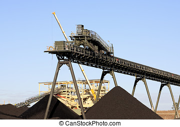 Coal Mining Conveyor Belt and piles of coal Australia