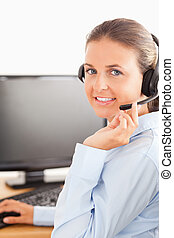 Close up of an office worker with a headset
