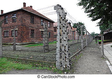 barracks in auschwitz - detail of electric fence in...