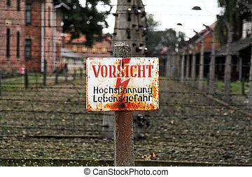 auschwitz warning signal for fence