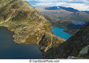 The Besseggen Ridge, which is Norway's most popular hiking trail, separating the lake Bessvatnet (on the left) from lake Gjende, which lies almost 400 meters lower in the Jotunheimen National Park, N