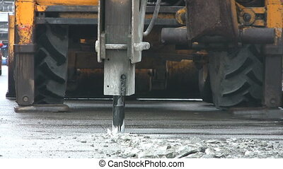 Breaking Up The Street - A heavy duty jackhammer begins to...
