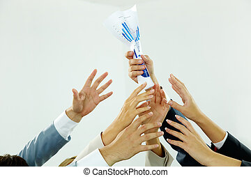 Reaching out for paper - Image of several human hands trying...