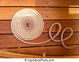 Coil of rope on a wooden boat