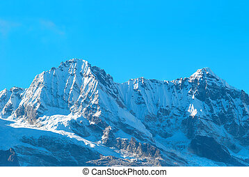High mountains, covered by snow.