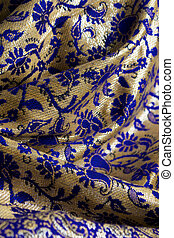 blue and gold fabric - Detail image of blue and gold fabric...