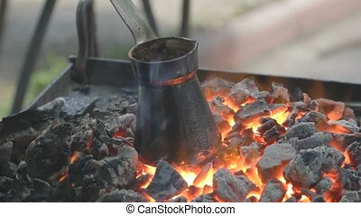 Charred pot with brewing coffee