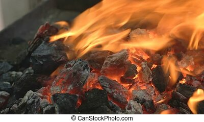 Close-up of glowing hot embers outd