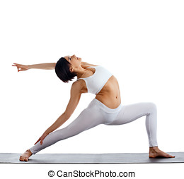 woman in white doing yoga - warrior asana isolated - young...