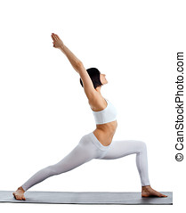 woman stand in yoga pose on rubber mat