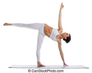 woman stand in yoga asana - half moon pose - young woman...