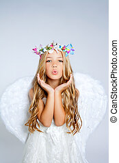 Angel little girl blowing expression with wings and flowers...