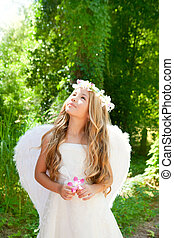Angel children girl holding flower in hand looking sky -...
