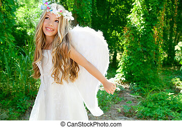 Angel children girl open arms in forest white wings - Angel...