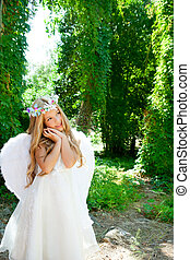 Angel children blond girl with sleeping hands gesture and...