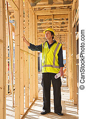 young man at the construction site - A young businessman at...