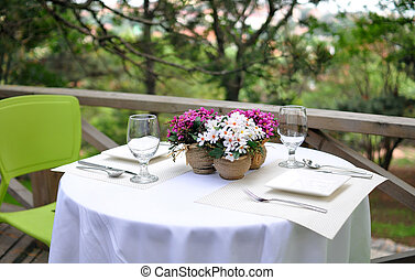 Dining table - A decorated dining table in a restraunt